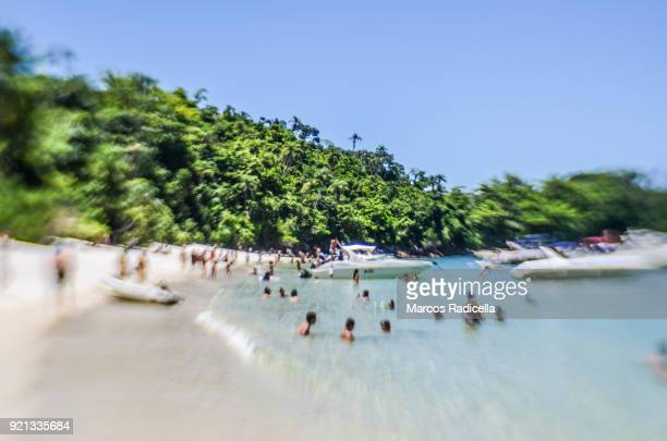 tourists enjoying a beach at ilha grande - radicella stock pictures, royalty-free photos & images