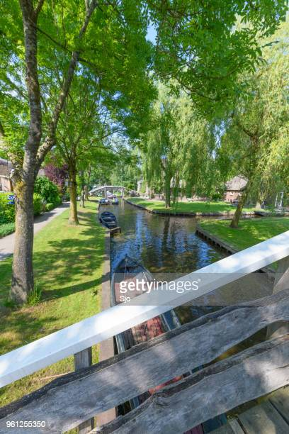 "tourists enjoying a boat tour on the canals of giethoorn in the netherlands - ""sjoerd van der wal"" or ""sjo"" stock pictures, royalty-free photos & images"