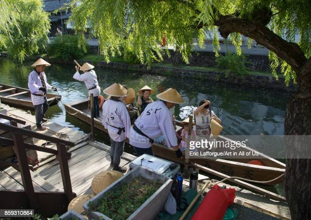 Tourists enjoying a cruise on a small boat on the river in Bikan historical quarter'n Okayama Prefecture Kurashiki Japan on August 25 2017 in...