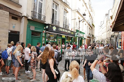 Tourists Enjoying at rue de Rosiers in Paris