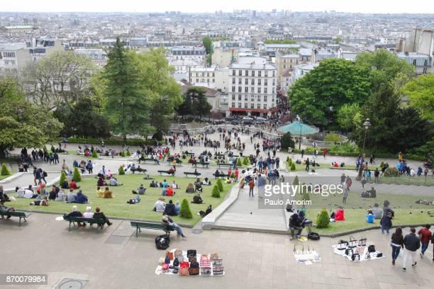 Tourists Enjoying at Square Louise Michel in Paris