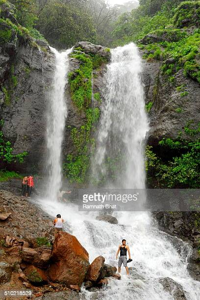 Tourists enjoying in water falls at Mahabaleshwar. Mahabaleshwar is major hill station and tourist attraction of Maharashtra.