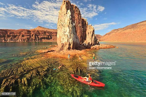 Tourists enjoying kayaking and snorkeling