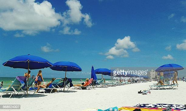 tourists enjoying on beach - st. petersburg florida stock photos and pictures