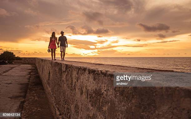 tourists enjoying the sunset in cartagena - cartagena colombia foto e immagini stock