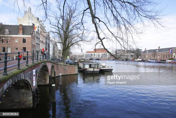 Tourists Enjoying the view at Amstel River in Amsterdam