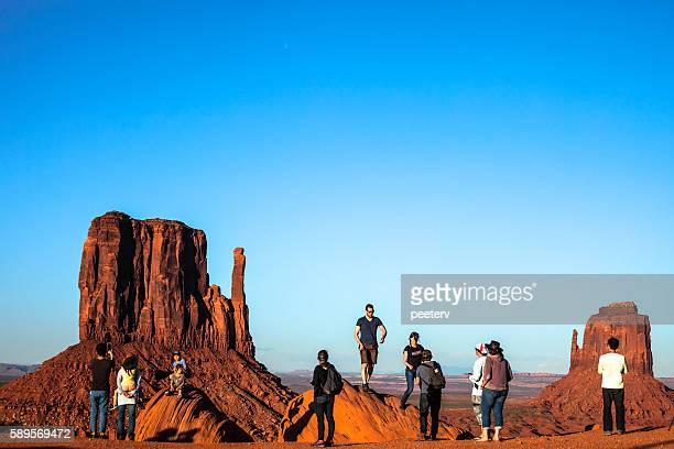 Tourists enjoying the view of Monument Valley.
