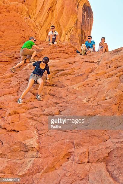tourists enjoying view at arches national park, utah usa - pavliha stock photos and pictures