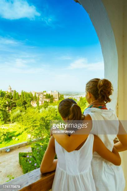 tourists enjoying views from the alhambra, spain - granada spain landmark stock pictures, royalty-free photos & images