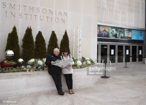 Tourists Enrico and Latisha Jacomini from Rome Italy look at a map after discovering the Smithsonian National Museum of American History is closed...