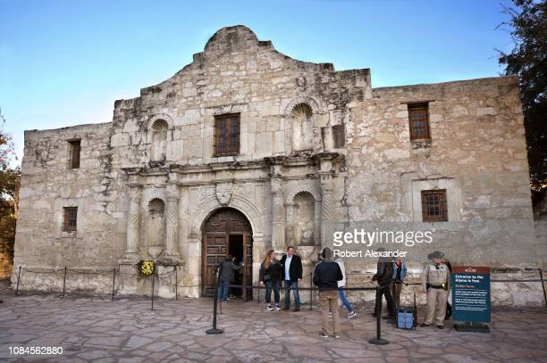 Tourists enter Mission San Antonio de Valero better known as The Alamo The former Franciscan mission was the site of the Battle of the Alamo in 1836...