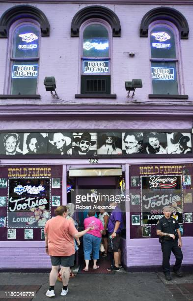 Tourists enter Tootsie's Orchid Lounge an iconic bar and live country music venue in the Lower Broadway entertainment district in Nashville Tennessee