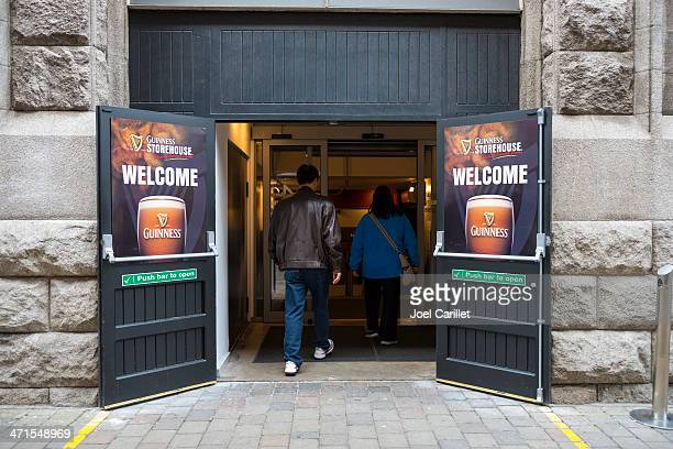 tourists entering guinness storehouse for tour - brand name stock pictures, royalty-free photos & images