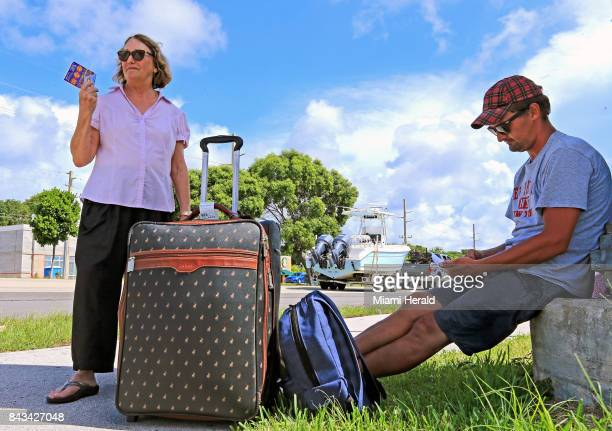 Tourists Erica Bourke of Australia and Jacob Botha of South Africa wait for a Greyhound bus on Wednesday Sept 6 2017 as they evacuate Key Largo in...
