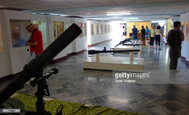 Tourists examine displays and weapons at the Museo de Playa Giron the Bay of Pigs Museum commemorating the 1961 victory of revolutionary forces under...