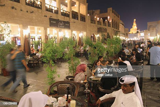 Tourists expats and locals mix in the Souq Waqif on October 25 2010 in Doha Qatar The Souq Waqif with its myriad of little streets containing shops...