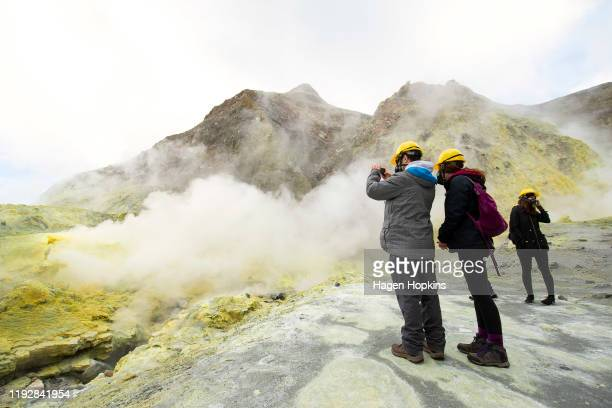Tourists explore White Island on July 9 2019 in Whakatane New Zealand