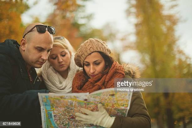 Tourists exploring map together