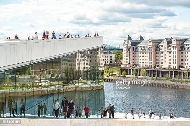 Tourists exploring Oslo Opera House, Norway