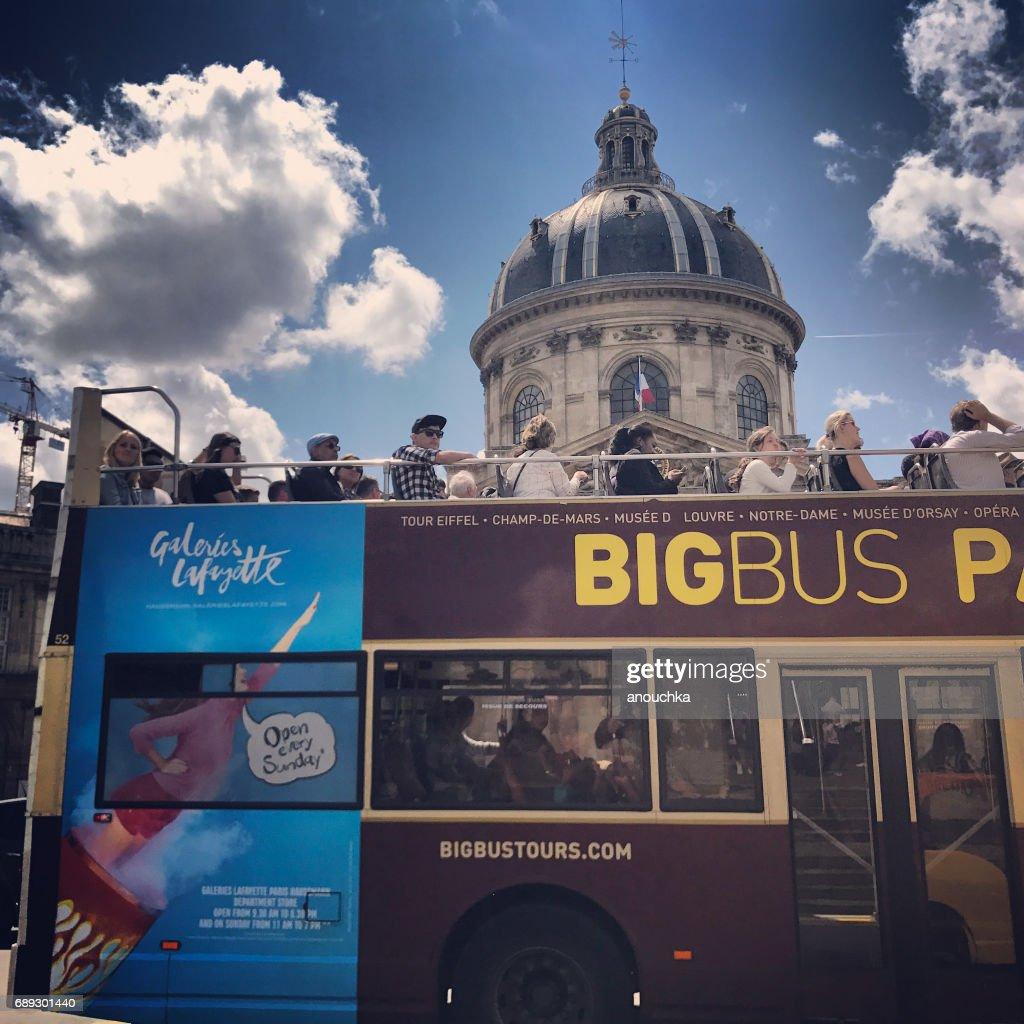 Tourists exploring Paris in tour bus, France : Stock Photo