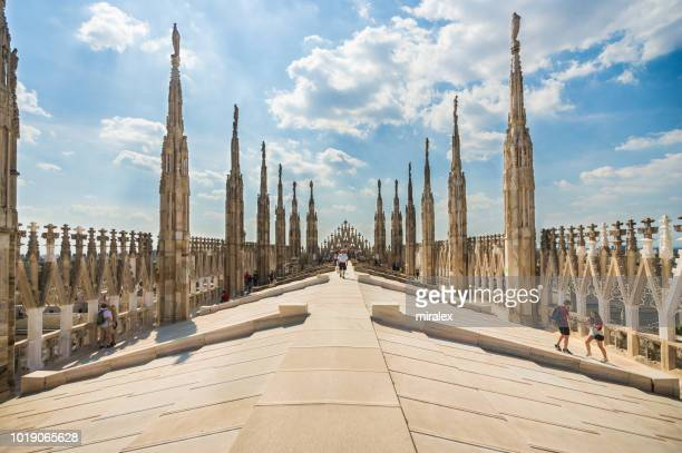 tourists exploring roof of cathedral of milan - duomo di milano - cathedral stock pictures, royalty-free photos & images