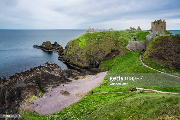 tourists exploring scotland's northeastern coast - dunnottar castle stock pictures, royalty-free photos & images