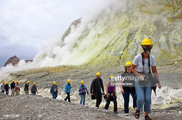 Tourists exploring the inner crater of New Zealand's only active marine volcano White Island It is located 49km off the coast of Whakatane New...