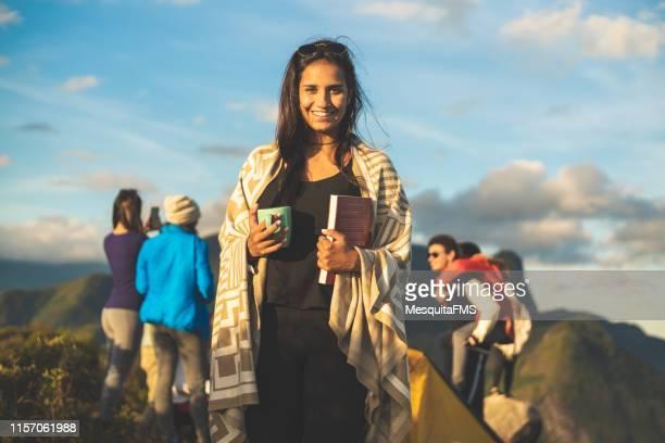 tourists exploring the mountains in (pedra do cortiço) in the serra dos orgãos national park, rio de janeiro, brazil - hot drink stock pictures, royalty-free photos & images