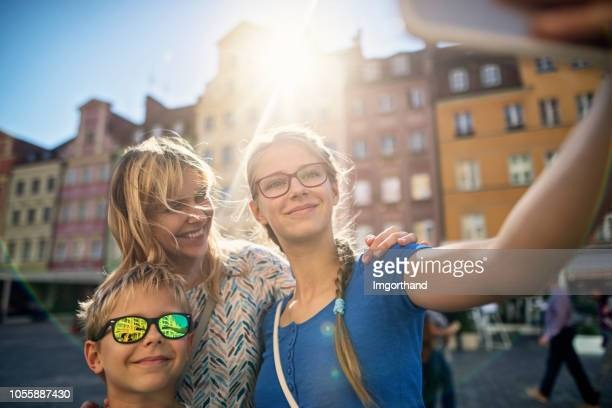Tourists family talking selfie in Market Square in Wrocław, Poland