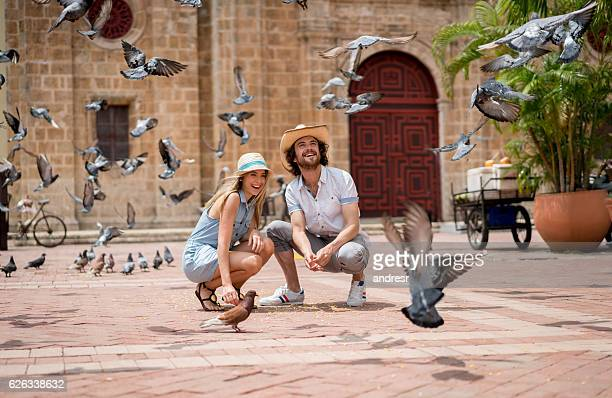 Tourists feeding doves in Cartagena