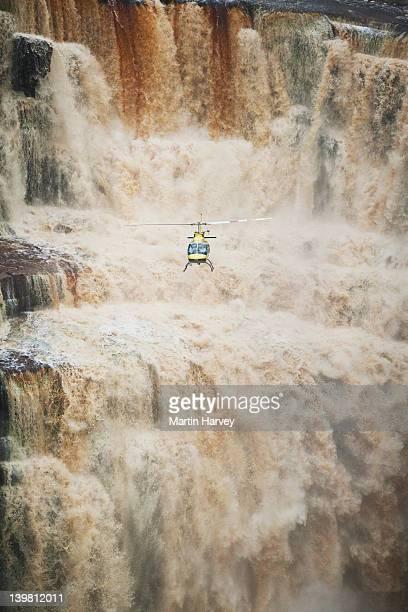 tourists flying in helicopter exploring the saikaka waterfall in guyana, south america - guyana fotografías e imágenes de stock