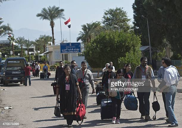 Tourists from India arrive in Egypt after crossing the Taba Land Port on February 18 two days after a tourist bus exploded in the Egyptian south...