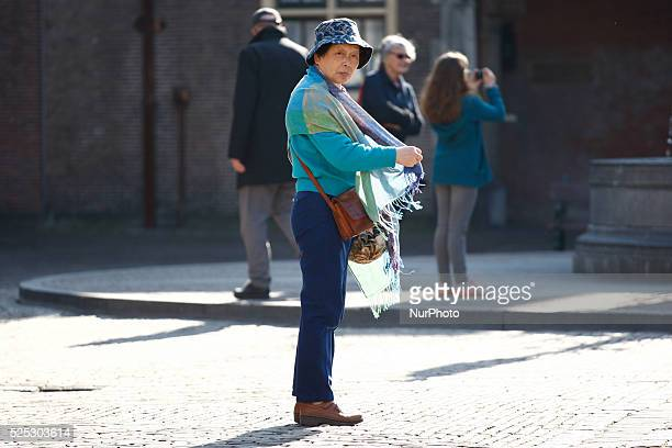 Tourists from Japan are seen on the quotBinnenhofquot the old square inside the parliamenary buildings in The Hague on Thursday