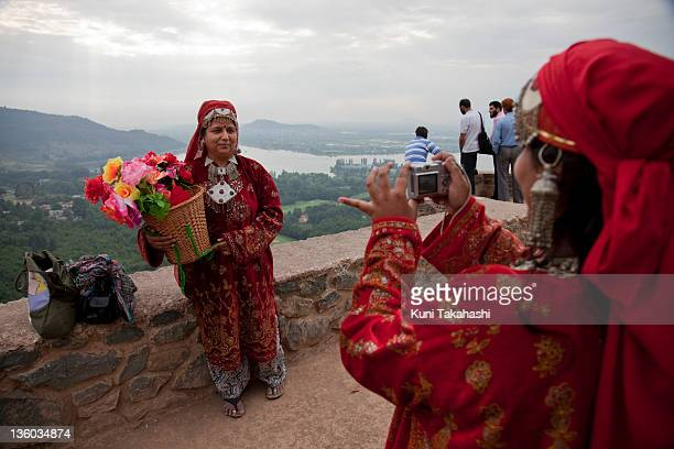 Tourists from Mumbai India wear local Kashmiri dresses for a picture at Pari Mahal one of the most visited places July 7 2011 in Srinagar Kashmir...