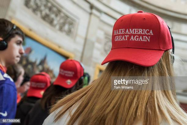 Tourists from North Carolina don 'Make America Great Again' hats in the Capitol Rotunda on the day the House will vote on the American Health Care...