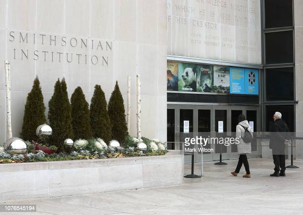 Tourists from Rome Italy Enrico and Latisha Jacomini discover that the Smithsonian National Museum of American History is closed due to the partial...
