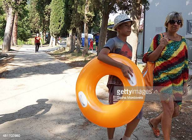 Tourists from Russia walk by the street on July 22 2015 in New Athos Abkhazia Football teams from rebel republics and separatist regions will gather...