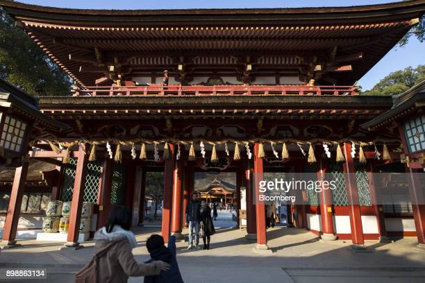 Tourists from South Korea pose at the Dazaifu Tenmangu shrine in Dazaifu Fukuoka Japan on Friday Dec 22 2017 Fukuoka on Japans southern island of...