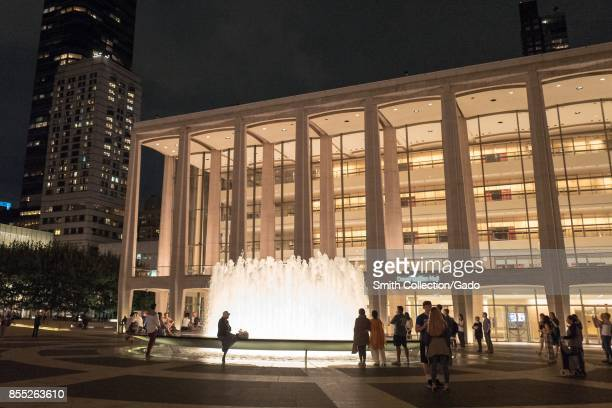 Tourists gather at the fountain at Lincoln Center in Manhattan New York City New York at night September 14 2017