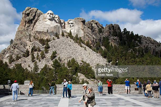 Tourists Gather at View of Mount Rushmore