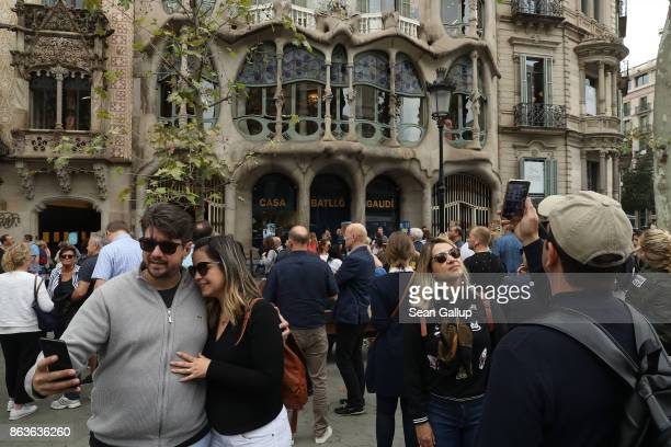 Tourists gather for snapshots and selfies in front of Casa Batllo designed by Catalan architect Antoni Gaudi on Passeig de Gracia avenue on October...