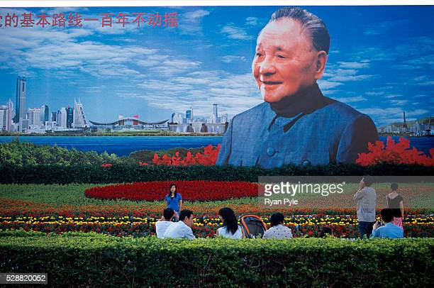 Tourists gather in front of the Deng Xiaoping poster in Shenzhen, China. Shenzhen is China's first completely planned city. The city was commissioned...