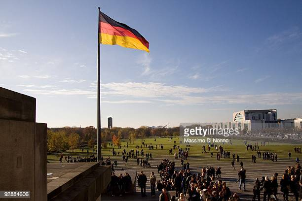 Tourists gather in front of the Reichstag on November 7 2009 in Berlin Germany The city of Berlin is to commemorate the 20th anniversary of fall of...