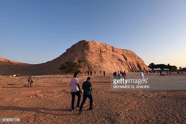 Tourists gather near the temple of Abu Simbel south of Aswan in upper Egypt to witness the sun illuminate the inner sanctuary on October 22 2016 /...