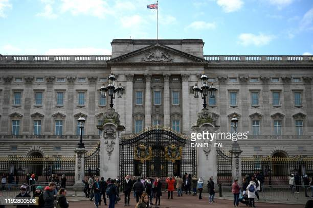 Tourists gather outside Buckingham Palace in London on January 10 2020 Prince Harry's wife Meghan has returned to Canada following the couple's...