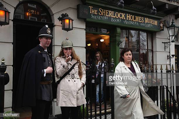Tourists gather outside the former home of the fictional Character Sherlock Holmes on April 5 2012 in London England 221B Baker Street is the London...
