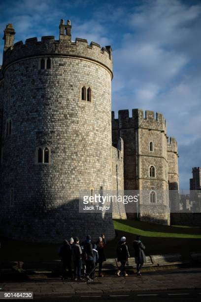 Tourists gather outside Windsor Castle on January 5 2018 in Windsor England British Prime Minister Theresa May has publicly challenged comments made...