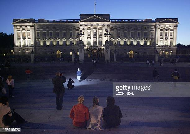 Tourists gather to watch the lights illuminating Buckingham Palace for the first time 24 October 2006 The lighting is set to be on every night until...