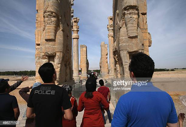Tourists gaze upon the Gate of All Nations at the ancient Persepolis archeological site on May 30, 2014 in Persepolis, Iran. The ruins mark the site...