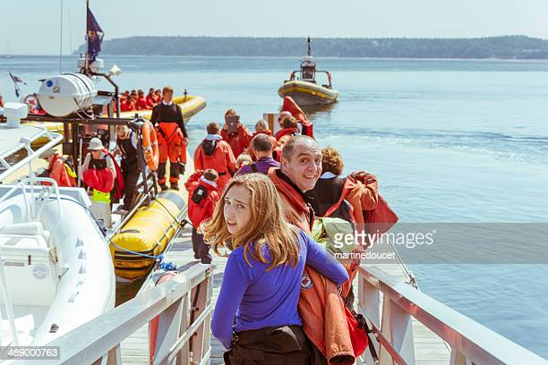 "tourists getting on a zodiac for a whale watching cruises. - ""martine doucet"" or martinedoucet stock pictures, royalty-free photos & images"